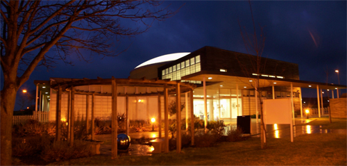 A dramatic night photo of the Thetford Healthy Living Centre
